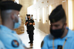 Police forces guard the special courtroom Wednesday, Sept. 8, 2021 in Paris. In a secure complex embedded within a 13th-century courthouse, France on Wednesday will begin the trial of 20 men accused in the Islamic State group's 2015 attacks on Paris that left 130 people dead and hundreds injured. (AP Photo/Thibault Camus)