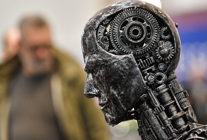 FILE - In this Nov. 29, 2019, file photo, a metal head made of motor parts symbolizes artificial intelligence, or AI, at the Essen Motor Show for tuning and motorsports in Essen, Germany. The Trump administration is proposing new rules guiding how the U.S. government regulates the use of artificial intelligence in medicine, transportation and other industries. The White House unveiled the proposals Tuesday, Jan. 7, and said they're meant to promote private sector applications of AI that are safe and fair. (AP Photo/Martin Meissner, File)