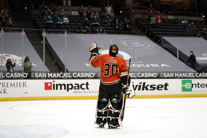 Playing his last home game, Anaheim Ducks goaltender Ryan Miller acknowledges the fans during the first period of the team's NHL hockey game against the Los Angeles Kings on Saturday, May 1, 2021, in Anaheim, Calif. Miller will retire at the conclusion of the season, ending an 18-year career. (AP Photo/Jae C. Hong)