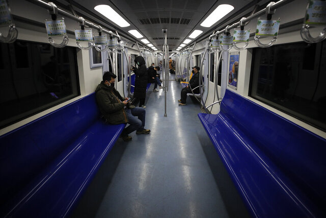 Commuters ride in a quiet subway train during the morning rush hour in Beijing, Monday, Feb. 17, 2020. Chinese authorities on Monday reported a slight upturn in new virus cases and hundred more deaths for a total of thousands since the outbreak began two months ago. (AP Photo/Andy Wong)