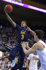 California guard Paris Austin, left, shoots as UCLA guard Jaime Jaquez Jr. defends during the first half of an NCAA college basketball game Sunday, Jan. 19, 2020, in Los Angeles. (AP Photo/Mark J. Terrill)