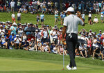 Fans cheer after Tiger Woods made par on the sixth hole during the second round of the PGA Championship golf tournament at Bellerive Country Club, Friday, Aug. 10, 2018, in St. Louis. (AP Photo/Charlie Riedel)
