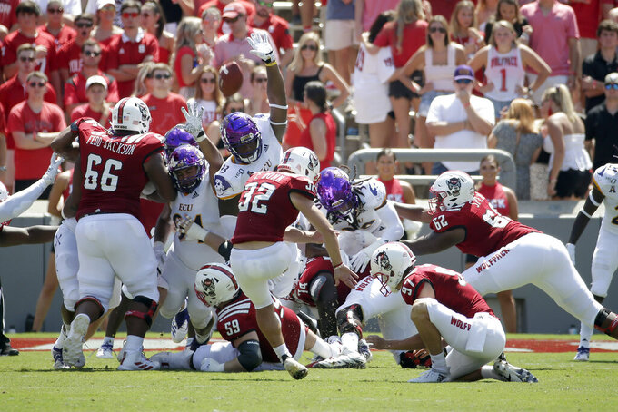 North Carolina State place kicker Christopher Dunn (32) kicks a field goal during the first half of an NCAA college football game against East Carolina in Raleigh, N.C., Saturday, Aug. 31, 2019. (AP Photo/Gerry Broome)