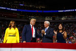 President Donald Trump and first lady Melania Trump stand with Vice President Mike Pence and Karen Pence during Trump's re-election kickoff rally at the Amway Center, Tuesday, June 18, 2019, in Orlando, fla. (AP Photo/Evan Vucci)