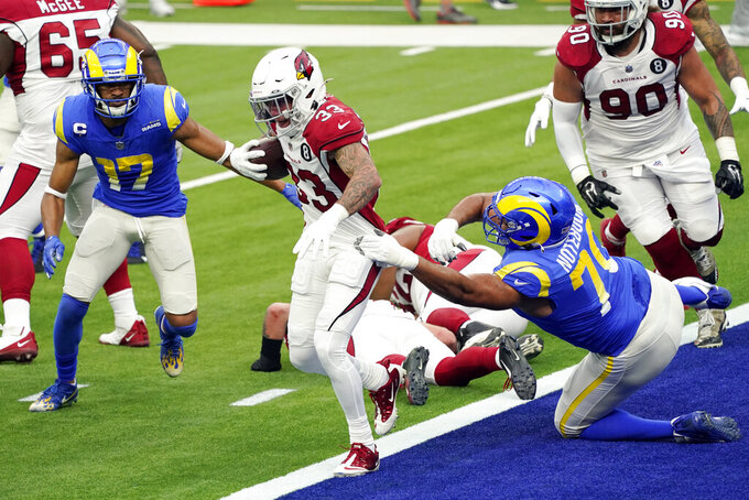 Arizona Cardinals cornerback Byron Murphy (33) runs after recovering a fumble by Los Angeles Rams running back Cam Akers during the first half of an NFL football game Sunday, Jan. 3, 2021, in Inglewood, Calif. (AP Photo/Ashley Landis)