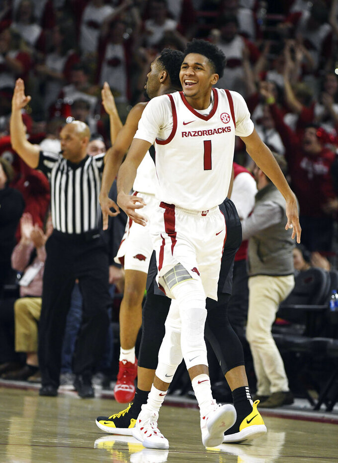 Arkansas guard Isaiah Joe (1) celebrates after hitting a 3-point shot against Missouri during the second half of an NCAA college basketball game, Wednesday, Jan. 23, 2019, in Fayetteville, Ark. (AP Photo/Michael Woods)