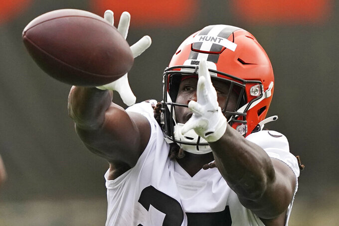 Cleveland Browns running back Kareem Hunt catches a pass during an NFL football practice, Thursday, July 29, 2021, in Berea, Ohio. (AP Photo/Tony Dejak)