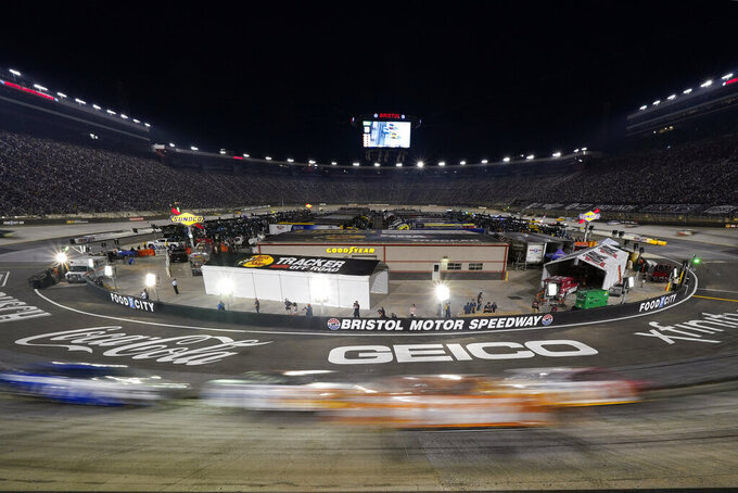 Drivers come through a turn during a NASCAR Cup Series auto race at Bristol Motor Speedway Saturday, Sept. 18, 2021, in Bristol, Tenn. (AP Photo/Mark Humphrey)