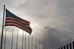 U.S. flag flies at the U.S. embassy in Havana, Cuba, Monday, March 18, 2019. The U.S. State Department said Friday, March, 15, 2019 that it is eliminating a coveted five-year tourist visa for Cubans, dealing a heavy blow to entrepreneurs and Cuban members of divided families, who used the visas to see relatives in the U.S. and buy precious supplies for their businesses on the island. (AP Photo/Ramon Espinosa)