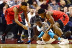 Toronto Raptors forward OG Anunoby, right, steals the ball from Charlotte Hornets guard Terry Rozier as Raptors guard Norman Powell (24) looks on during first half NBA action in Toronto on Monday, Nov. 18, 2019. (Frank Gunn/The Canadian Press via AP)