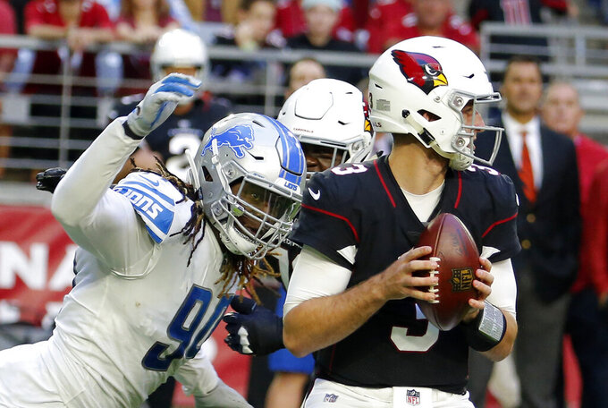 FILE - In this Sunday, Dec. 9, 2018, file photo, Detroit Lions defensive end Ezekiel Ansah, left, rushes Arizona Cardinals quarterback Josh Rosen (3) during an NFL football game, in Glendale, Ariz. The Seattle Seahawks are addressing one of their biggest offseason needs as veteran defensive end Ansah has agreed to a one-year deal with the team, according to a person with knowledge of the deal, Wednesday, May 8, 2019. (AP Photo/Rick Scuteri, File)