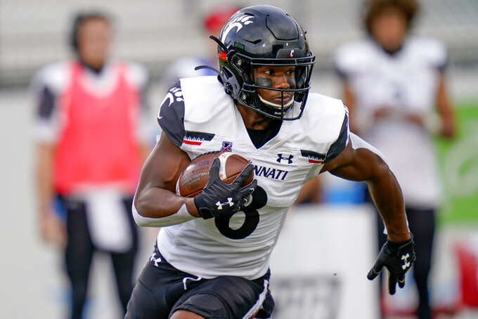 Cincinnati wide receiver Michael Young Jr. runs against Central Florida after a reception during the first half of an NCAA college football game, Saturday, Nov. 21, 2020, in Orlando, Fla. (AP Photo/John Raoux)
