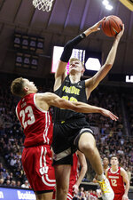 Wisconsin center Joe Hedstrom (32) shoots over Wisconsin guard Kobe King (23) during the second half of an NCAA college basketball game in West Lafayette, Ind., Friday, Jan. 24, 2020. (AP Photo/Michael Conroy)