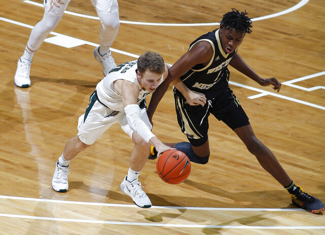 Michigan State's Jack Hoiberg, left, and Western Michigan's Chase Barrs vie for the ball during the first half of an NCAA college basketball game, Sunday, Dec. 29, 2019, in East Lansing, Mich. (AP Photo/Al Goldis)