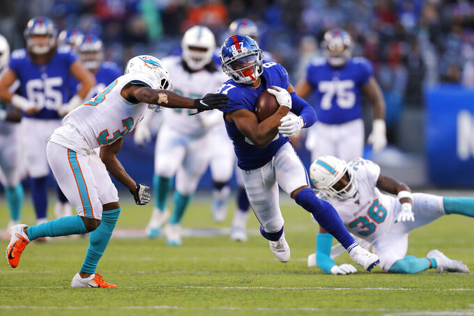 Miami Dolphins cornerback Jomal Wiltz (33) tries to stop New York Giants wide receiver Sterling Shepard (87) in the second half of an NFL football game, Sunday, Dec. 15, 2019, in East Rutherford, N.J. (AP Photo/Adam Hunger)