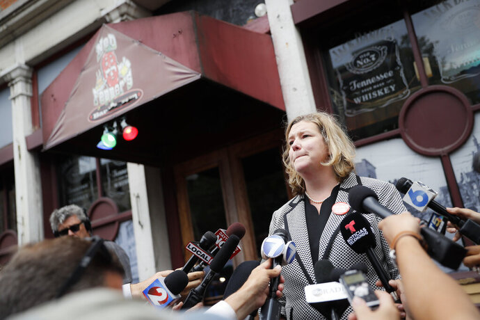 """FILE - In this Aug. 6, 2019 file photo, Dayton, Ohio, Mayor Nan Whaley speaks to members of the media outside Ned Peppers bar in the Oregon District after a mass shooting that occurred early Sunday morning in Dayton.  With a period of around 10 weeks, Dayton dealt with a Ku Klux Klan rally, a string of devastating tornadoes, and a mass shooting that killed nine people.  Whaley says those events reflect a lack on action on national issues of white supremacist activity, climate change and gun violence. Her end-of-the-year reflections include searing memories of the natural disaster and attack as she looks ahead to a year dedicated to """"healing and transformation."""" (AP Photo/John Minchillo)"""