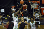 Oregon forward Eugene Omoruyi (2) drives to the basket during the second half of an NCAA college basketball game Saturday, Jan. 2, 2021 in Eugene, Ore. Oregon won the game 73-56. (AP Photo/Andy Nelson)
