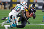Pittsburgh Steelers running back James Conner , right, is tackled by Miami Dolphins defensive back Chris Lammons, left, during the first half of an NFL football game in Pittsburgh, Monday, Oct. 28, 2019. (AP Photo/Keith Srakocic)