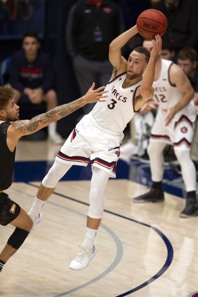 Saint Mary's guard Jordan Ford (3) looks to pass around Winthrop guard Hunter Hale (13) during the second half of an NCAA college basketball game, Monday, Nov. 11, 2019 in Moraga, Calif. Winthrop upset 18th-ranked Saint Mary's 61-59. (AP Photo/D. Ross Cameron)
