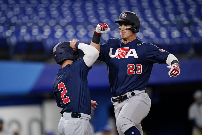 United States' Tyler Austin, right, celebrate with Eddy Alvarez after hitting a home run in the third inning of a a baseball game against Israel at the 2020 Summer Olympics, Friday, July 30, 2021, in Yokohama, Japan. (AP Photo/Sue Ogrocki)