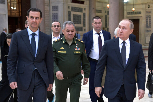 Russian President Vladimir Putin, right, Syrian President Bashar Assad, left, and Russian Defense Minister Sergei Shoigu, center, visit the Umayyad Mosque in Damascus, Syria, Tuesday, Jan. 7, 2020. Putin has traveled to Syria to meet with President Bashar Assad, a key Iranian ally. The rare visit Tuesday comes amid soaring tensions between Iran and the United States following the U.S. drone strike last week that killed a top Iranian general who led forces supporting Assad in Syria's civil war. (Alexei Nikolsky/Sputnik, Kremlin Pool Photo via AP)