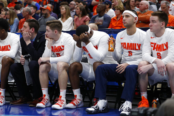 The Syracuse bench reacts in the final minutes of a first-round game against Baylor in the NCAA men's college basketball tournament Thursday, March 21, 2019, in Salt Lake City. (AP Photo/Jeff Swinger)