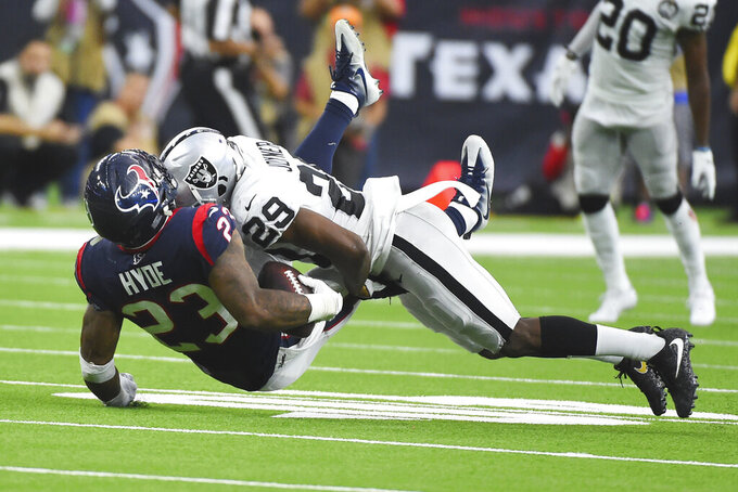 Houston Texans running back Carlos Hyde (23) is hit by Oakland Raiders free safety Lamarcus Joyner (29) during the second half of an NFL football game Sunday, Oct. 27, 2019, in Houston. (AP Photo/Eric Christian Smith)