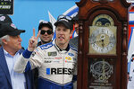 Brad Keselowski (2) celebrates with the trophy grandfather clock in Victory Lane after winning a NASCAR Cup Series auto race at Martinsville Speedway in Martinsville, Va., Sunday, March 24, 2019. (AP Photo/Steve Helber)