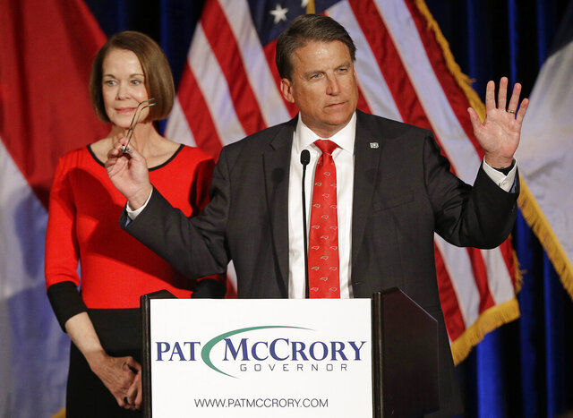 FILE - In this Nov. 9, 2016 file photo, North Carolina Gov. Pat McCrory speaks to supporters as his wife Ann McCrory listens at an election rally in Raleigh, N.C.  McCrory announced Thursday, Dec. 19, 2019,  that he won't try to recapture his old office in 2020, but will continue to consider a U.S. Senate bid in 2022. (AP Photo/Chuck Burton, File)