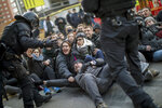 Catalan police officers remove demonstrators blocking a road leading to Barcelona city, during a general strike in Catalonia, Spain, Thursday, Feb. 21, 2019. Strikers advocating for Catalonia's secession from Spain are blocking major highways, train lines and roads across the northeastern region. (AP Photo/Emilio Morenatti)