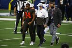 Cleveland Browns running back Nick Chubb (24) is assisted off the field by staff after suffering an unknown injury in the first half of an NFL football game against the Dallas Cowboys in Arlington, Texas, Sunday, Oct. 4, 2020. (AP Photo/Michael Ainsworth)