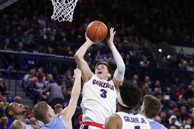 FILE - In this Feb. 27, 2020, file photo, Gonzaga forward Filip Petrusev (3), of Serbia, shoots during the second half of an NCAA college basketball game against San Diego in Spokane, Wash. Gonzaga forward Filip Petrusev has become the third Bulldog to declare for the NBA draft this year without hiring an agent. Gonzaga's leading scorer and the West Coast Conference player of the year, Petrusev made his announcement Sunday, April 26, 2020, the deadline for players to declare. (AP Photo/Young Kwak, File)