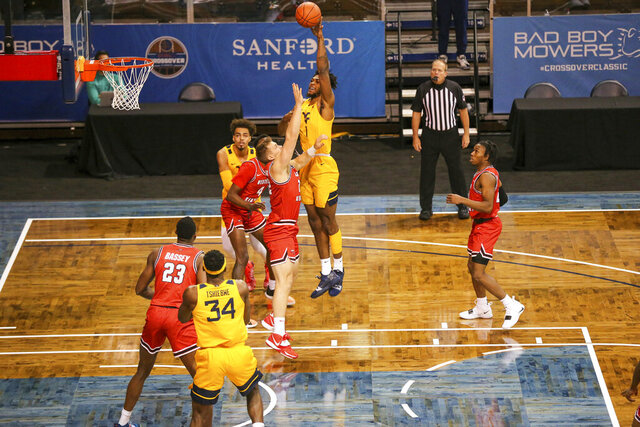 West Virginia forward Derek Culver (1) shoots over a Western Kentucky defender during the first half of an NCAA college basketball game Friday, Nov. 27, 2020, in SIoux Falls, S.D. (AP Photo/Josh Jurgens)
