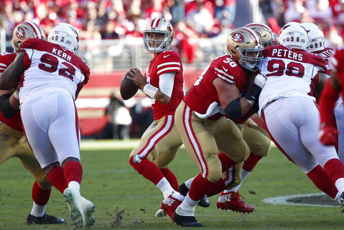San Francisco 49ers quarterback Jimmy Garoppolo, center, passes against the Arizona Cardinals during the first half of an NFL football game in Santa Clara, Calif., Sunday, Nov. 17, 2019. (AP Photo/Josie Lepe)