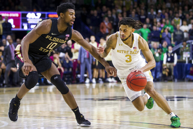 File-This March 4, 2020, file photo shows Notre Dame's Prentiss Hubb (3) driving as Florida State's Malik Osborne (10) defends during the second half of an NCAA college basketball game in South Bend, Ind. The 6-foot-3 Hubb, who played high school at Gonzaga in Washington, D.C., averaged 12.1 points and 5.1 assists per game in his 32 starts. (AP Photo/Robert Franklin, File)