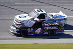 Raphael Lessard (4) races Trevor Bayne (45) to the finish line on the final lap during the NASCAR Truck series auto race at Talladega Superspeedway Saturday, Oct. 3, 2020, in Talladega, Ala. Lessard won the race. (AP Photo/John Bazemore)