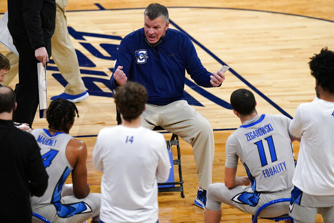 Creighton coach Greg McDermott talks to players during the first half of the team's NCAA college basketball game against Connecticut in the semifinals in the Big East men's tournament Friday, March 12, 2021, in New York. (AP Photo/Frank Franklin II)