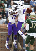 James Madison's  Kyndel Dean, left, celebrates a touchdown with teammate Devin Ravenel during the second  half of an NCAA college football game in Williamsburg, Va., on Saturday, Oct. 19, 2019.  (Daniel Sangjib Min/Richmond Times-Dispatch via AP)