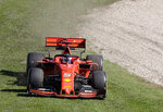 Ferrari driver Sebastian Vettel of Germany leaves the track in the first corner during the second practice session of the Australian Grand Prix in Melbourne, Australia, Friday, March 15, 2019. The first race of the year is Sunday. (AP Photo/Rick Rycroft)
