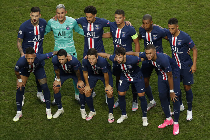 Team PSG pose prior to the Champions League final soccer match between Paris Saint-Germain and Bayern Munich at the Luz stadium in Lisbon, Portugal, Sunday, Aug. 23, 2020. (AP Photo/Manu Fernandez, Pool)