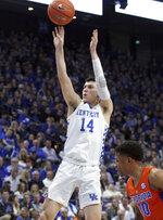 Kentucky's Tyler Herro (14) shoots near Florida's Noah Locke (10) during the first half of an NCAA college basketball game in Lexington, Ky., Saturday, March 9, 2019. (AP Photo/James Crisp)
