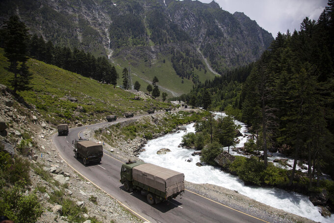"""FILE- In this June 17, 2020, file photo, an Indian army convoy moves on the Srinagar- Ladakh highway at Gagangeer, north-east of Srinagar, India. India said Monday its soldiers thwarted China's """"provocative"""" military movements near a disputed border in Ladakh region amid a monthslong standoff. (AP Photo/Mukhtar Khan, File)"""