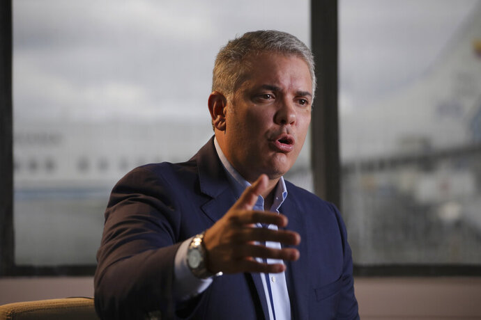 Colombia's President Ivan Duque speaks during an interview with The Associated Press before departing, to attend the United Nations General Assembly, from the CATAM air base in Bogota, Colombia, Saturday, Sept. 21, 2019. Duque's will speak before the General Assembly and is expected to condemn Venezuelan leader Nicolás Maduro as an abusive autocrat who is not only responsible for the country's humanitarian catastrophe but is also now a threat to regional stability for his alleged harboring of Colombian rebels labeled a terrorist group by the U.S. and European Union. (AP Photo/Ivan Valencia)