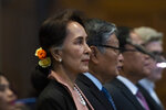 Myanmar's leader Aung San Suu Kyi stands in the court room of the International Court of Justice for the first day of three days of hearings in The Hague, Netherlands, Tuesday, Dec. 10, 2019. Aung San Suu Kyi will represent Myanmar in a case filed by Gambia at the ICJ, the United Nations' highest court, accusing Myanmar of genocide in its campaign against the Rohingya Muslim minority. (AP Photo/Peter Dejong)