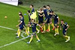 Rostov's players celebrate after scoring their side's goal during a Russia Soccer Premier League soccer match against FC Sochi, as the league was resumed after a three-month hiatus because of the coronavirus pandemic in Sochi, Russia, Friday, June 19, 2020. Rostov fielded a team of teenagers because its entire first-team squad is in isolation following a suspected outbreak of coronavirus. The match is being played with a minimum spectators to curb the spread of COVID-19. (AP Photo)