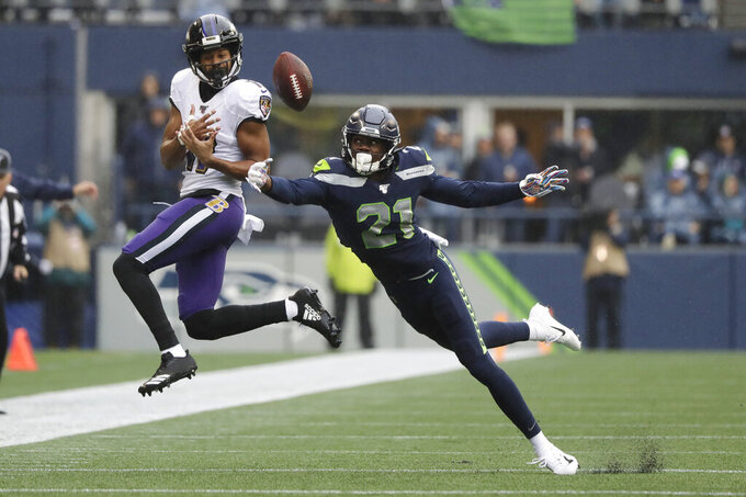 Seattle Seahawks cornerback Tre Flowers (21) tips a pass intended for Baltimore Ravens Seth Roberts (11) for an incomplete during the first half of an NFL football game, Sunday, Oct. 20, 2019, in Seattle. (AP Photo/Elaine Thompson)