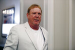 FILE - Oakland Raiders owner Mark Davis arrives to the NFL football owners meeting in Key Biscayne, Fla., in this  May 22, 2019, file photo. Mark Davis is expanding his sports empire in Las Vegas, buying the Aces from MGM Resorts International. The Raiders owner purchased the WNBA team Thursday, Jan. 14, 2021, pending approval from the league's board of governors. (AP Photo/Brynn Anderson, File)