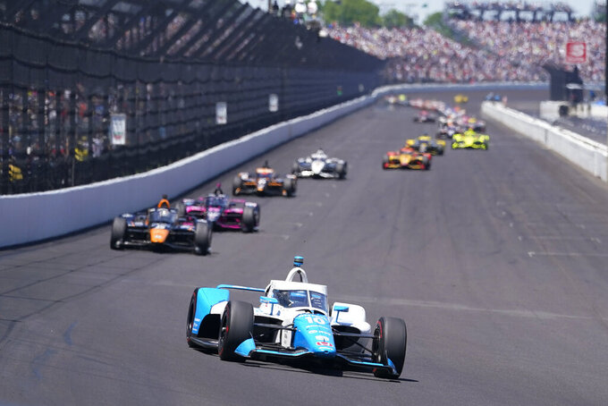 Alex Palou, of Spain, drives into Turn 1 during the Indianapolis 500 auto race at Indianapolis Motor Speedway, Sunday, May 30, 2021, in Indianapolis. (AP Photo/Darron Cummings)