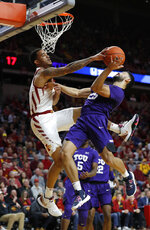 Iowa State guard Nick Weiler-Babb, left, blocks a shot by TCU guard Alex Robinson, right, during the first half of an NCAA college basketball game, Saturday, Feb. 9, 2019, in Ames. (AP Photo/Matthew Putney)