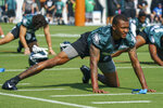Philadelphia Eagles wide receiver DeVonta Smith stretches during practice at NFL football training camp, Wednesday, July 28, 2021, in Philadelphia. (AP Photo/Chris Szagola)